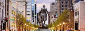 Header - Client Portal Raleigh Statue